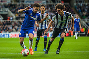 Chelsea FC Cesc Fabergas takes on Newcastle United Fabricio Coloccini during the Barclays Premier League match between Newcastle United and Chelsea at St. James's Park, Newcastle, England on 26 September 2015. Photo by Craig McAllister.