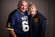 "Highland, Maryland - December 04, 2018: Greg Horne with his wife Pam Horne at their home in Highland, Md Monday Dec. 3, 2018. Pam wears her original USNA parka from 1968, Greg's senior year, and while they dated. A similar parka was bet for Greg on his behalf during the 1964 Army Navy game, which he lost.<br /> <br /> Unbeknownst to him, fifty-four-years-ago, a bet was placed on Naval Academy cadet Greg Horne's benefit, while he was recovering from an injury. Navy lost to Army and he owed Ed Dewey, a West Point cadet, a USNA parka. <br /> <br /> Ed even sent a follow-up letter asking Greg to ""pay-up."" -- but Greg was at sea, and his mail was forwarded to his mother's home. He found the then 52-year-old letter, while he and his siblings cleaned out their late mother's house in 2016. It took some time, but Greg tracked down Ed. <br /> <br /> The parkas are not longer made, so to make good on his bet, he sent Ed a commemorative USNA blanket, similar to one he owns. <br /> <br /> CREDIT: Matt Roth for The New York Times<br /> Assignment ID: 30228001A"