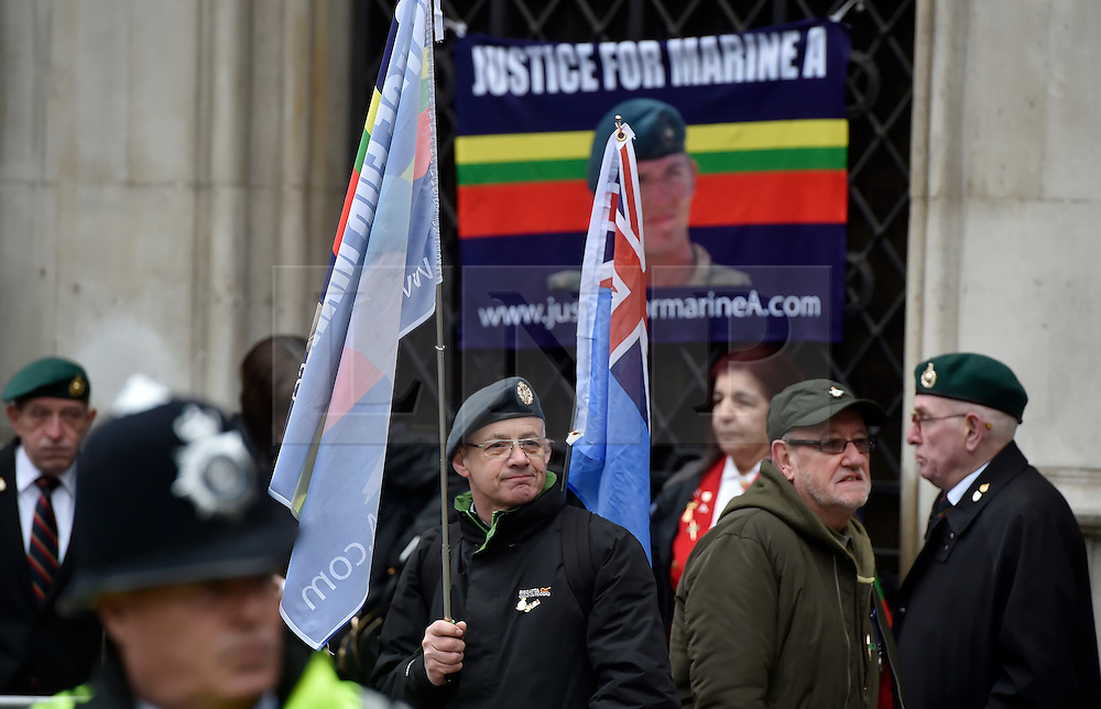 © Licensed to London News Pictures. 08/02/2017. London, UK. Supporters of Sergeant Alexander Blackman stands outside the Royal Courts of Justice in London, where Sgt Blackman has begun an appeal against his life sentence for the murder of a wounded Taliban fighter in Afghanistan in 2011Photo credit: Hannah McKay/LNP