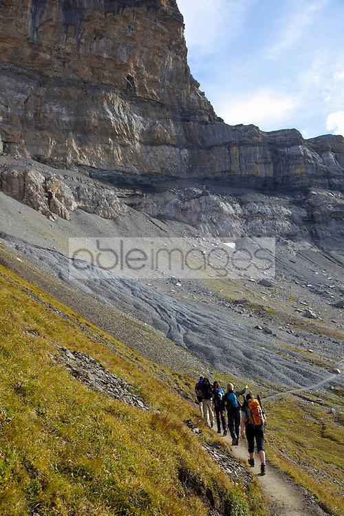 Friends Walking Eiger Trail in Bernese Oberland