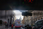 Bus rear advertising for Abba's West End musical Mamma Mia as it drives down Fleet Street and central London streets.