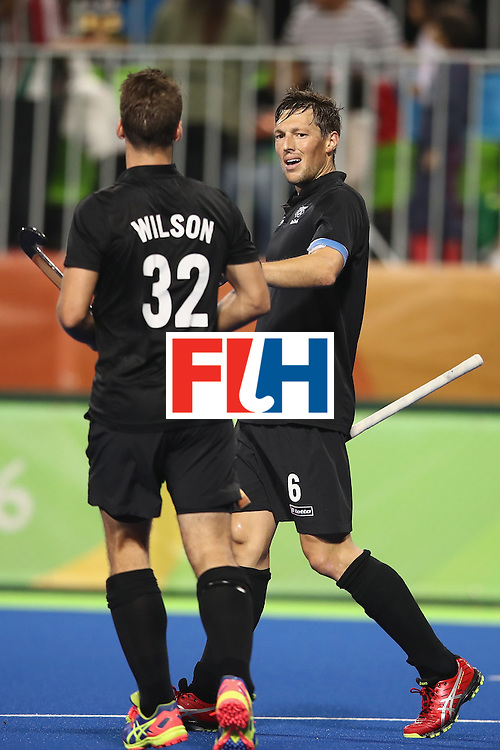 RIO DE JANEIRO, BRAZIL - AUGUST 10:  Nick Wilson of New Zealand congratulates Simon Child of New Zealand as he celebrates scoring a goal during the men's pool A match between New Zealand and Brazil on Day 5 of the Rio 2016 Olympic Games at the Olympic Hockey Centre on August 10, 2016 in Rio de Janeiro, Brazil.  (Photo by Mark Kolbe/Getty Images)