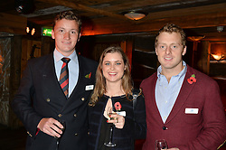 Left to right, WILFRID VAN GEEST, CLARE JOY and LUKE MASON who was awarded the Conspicuous Gallantry Cross for leading his men to safety in Afghanistan at Skiing With Heroes Junior Committee Awareness Party held at Bodo's Schloss, 2A Kensington High Street, London on 6th November 2014.