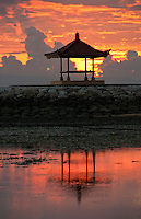Pagoda silhouetted against the rising sun in Bali, Indonesia