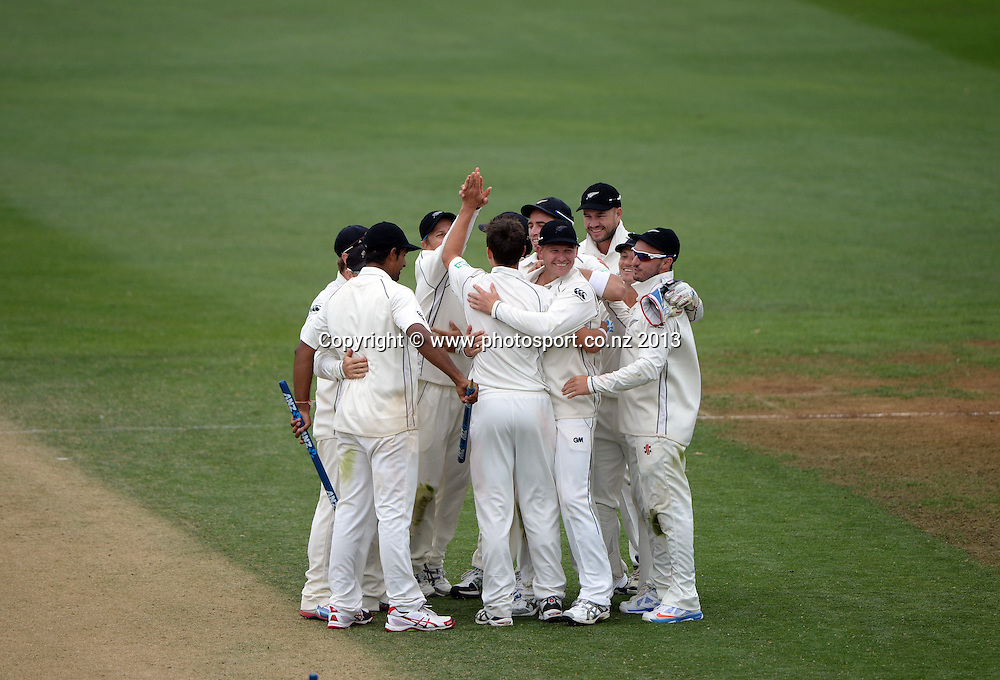 Trent Boult celebrates with team mates after taking 10 wickets on Day 3 of the 2nd cricket test match of the ANZ Test Series. New Zealand Black Caps v West Indies at The Basin Reserve in Wellington. Friday 13 December 2013. Mandatory Photo Credit: Andrew Cornaga www.Photosport.co.nz