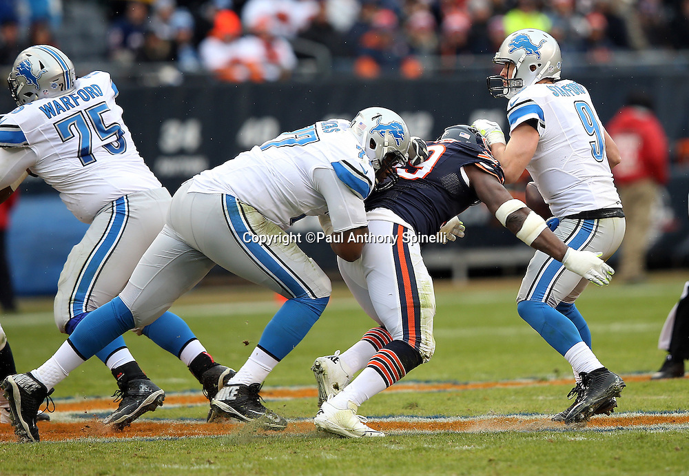 Chicago Bears linebacker Lamarr Houston (99) beats a block by Detroit Lions tackle Cornelius Lucas (77) as he sacks Detroit Lions quarterback Matthew Stafford (9) in the second quarter during the NFL week 17 regular season football game against the Detroit Lions on Sunday, Jan. 3, 2016 in Chicago. The Lions won the game 24-20. (©Paul Anthony Spinelli)