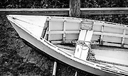 Strongly contrasting against in its surroundings, the bow, seat and gunnels of this old boat make for an interesting composition.  The antique character and the sign make this boat and interesting artifact at a local restaurant at Ocean Isle Beach, NC.  The image was post-processed with Exposure 7 to emulate Agfa APX 100 black & white film.
