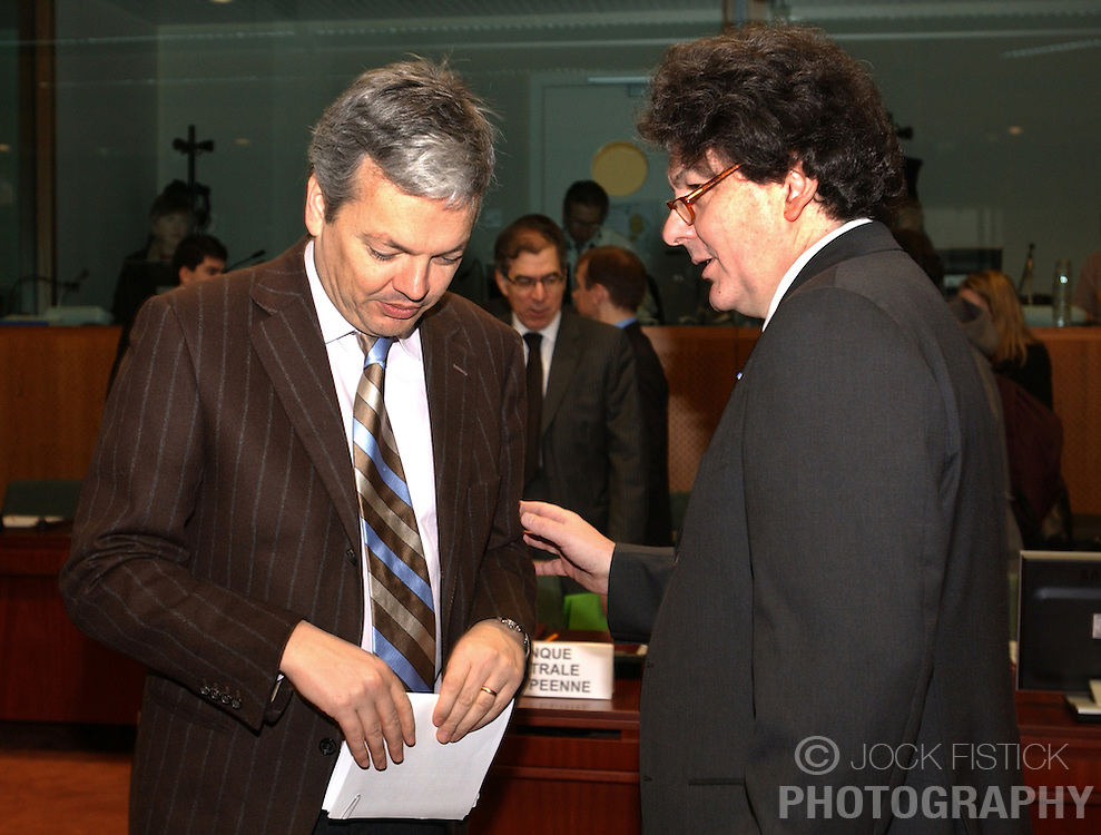 BRUSSELS, BELGIUM - MARCH-08-2005 - Didier Reynders, Belgium's finance minister, left, speaks with and Thierry Breton, France's finance minister, during Ecofin , the gathering of all the European Union economic and finance Ministers.