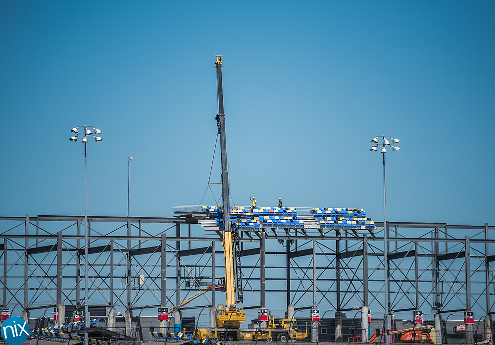 Seats in Turn Four of Charlotte Motor Speedway are being disassembled.