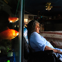 060113  Adron Gardner/Independent<br /> <br /> Nadine Chapito relaxes near an aquarium of goldfish at her home in Zuni Friday. &quot;I didn't know what a normal life was growing up in a home of alcoholics,&quot; Chapito said.