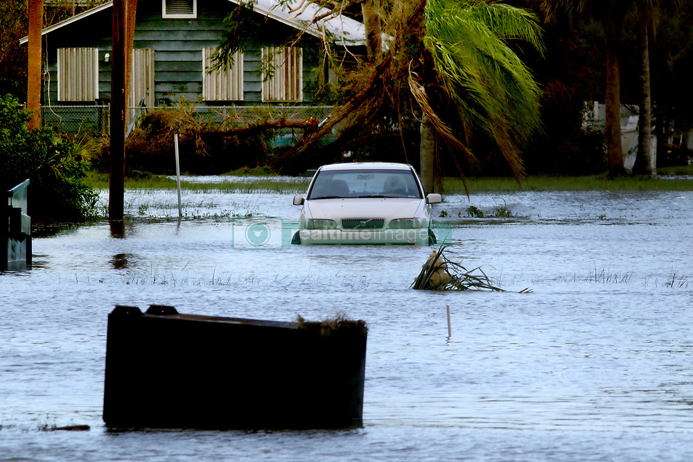 September 11, 2017 - Everglades City, Florida, U.S. - A car remains flooded off Collier Avenue on Monday in downtown Everglades City, which became inundated with water in the aftermath of Hurricane Irma's landfall on Sunday. (Credit Image: © Douglas R. Clifford/Tampa Bay Times via ZUMA Wire)