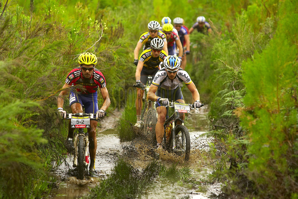 WESTERN CAPE, SOUTH AFRICA -  5 April 2008, David George leads Karl Platt through a water crossing during stage eight of the 2008 Absa Cape Epic Mountain Bike stage race from Oak Valley, Elgin to Lourensford Estate, Somerset West in the Western Cape, South Africa..Photo by Gary Perkin/SPORTZPICS