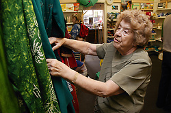 Woman volunteer working in charity shop,