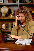 Business woman age 32 working in office.  St Paul Minnesota USA
