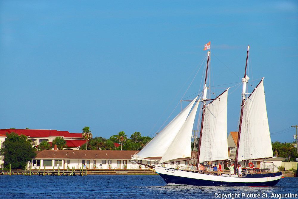 In St. Augustine, Florida the Schooner with its deck full of guest, sails through Matanza's Bay out for an afternoon adventure.