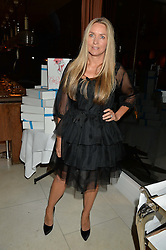 COLLETTE DINNIGAN at a dinner to celebrate the publication of Obsessive Creative by Collette Dinnigan hosted by Charlotte Stockdale and Marc Newson held at Mr Chow, Knightsbridge, London on 9th February 2015.