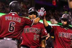 SAN FRANCISCO, CA - APRIL 20: Welington Castillo #7 of the Arizona Diamondbacks is congratulated by David Peralta #6 and Yasmany Tomas #24 after hitting a two run home run against the San Francisco Giants during the seventh inning at AT&T Park on April 20, 2016 in San Francisco, California.  (Photo by Jason O. Watson/Getty Images) *** Local Caption *** Welington Castillo; David Peralta; Yasmany Tomas