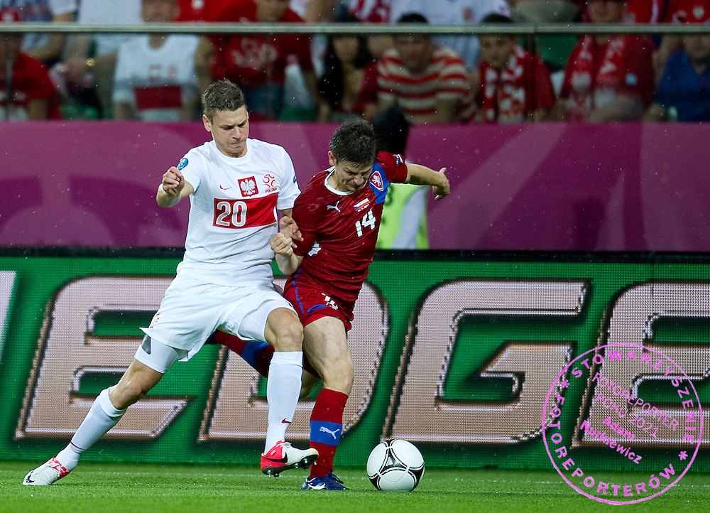 (L) Poland's Lukasz Piszczek (nr20) fights for the ball with (R) Czech's Vaclav Pilar (nr14) during the UEFA EURO 2012 Group A football match between Poland and Czech Republic at Municipal Stadium in Wroclaw on June 16, 2012...Poland, Wroclaw, June 16, 2012..Picture also available in RAW (NEF) or TIFF format on special request...For editorial use only. Any commercial or promotional use requires permission...Photo by © Adam Nurkiewicz / Mediasport