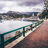 Catalina Island Avalon Bay Casino Way walkway photo. Picture includes Catalina Island Yacht Club and Avalon city waterfront businesses. Catalina Island is a popular travel destination off the coast of Southern California in the United States.