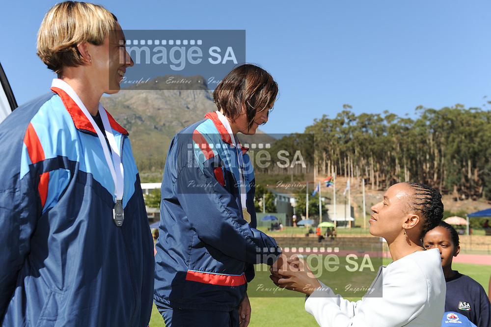 STELLENBOSCH, South Africa - Saturday 13 April 2013, Maryke Oberholzer receives her medal from Norma Nonkonyana during day 2 of the South African Senior Athletics championships at the University of Stellenbosch's Coetzenburg stadium.Photo by Roger Sedres/ ImageSA