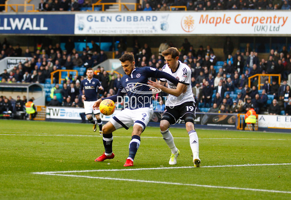 Millwall's Lee Gregory and Sheffield United's Richard Stearman during the EFL Sky Bet Championship match between Millwall and Sheffield Utd at The Den, London, England on 2 December 2017. Photo by John Marsh.