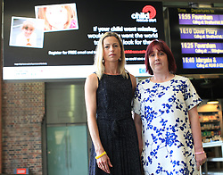***LNP HIGHLIGHTS OF THE WEEK ***  © Licensed to London News Pictures. London, UK. 20/05/2014.CORAL JONES (mother of April Jones),right, and KATE MCCANN (mother of Madeleine McCann) unveil a new Child Rescue Alert digital billboard today at St Pancras station, London, ahead of the International Missing Children's Day. The billboard campaign features images of April Jones and Madeleine McCann who were both abducted.