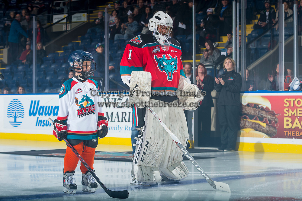 KELOWNA, CANADA - OCTOBER 27: The Pepsi player lines up alongside James Porter #1 of the Kelowna Rockets against the Tri-City Americans on October 27, 2017 at Prospera Place in Kelowna, British Columbia, Canada.  (Photo by Marissa Baecker/Shoot the Breeze)  *** Local Caption ***