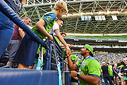 QB Russell Wilson of the Seattle Seahawks, shakes hands and signs autographs before the a MLS soccer match between the LA Galaxy and the Seattle Sounders on Saturday, September 1, 2019, in Seattle, Washington. (Alika Jenner/Image of Sport via AP)