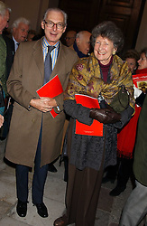 SIR TIM & LADY SAINSBURY at Carols from Chelsea in aid of the Institute of Cancer Research at the Royal Hospital Chapel, Chelsea, London on 1st December 2005.<br />