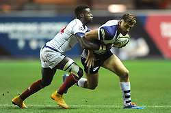 Bristol Rugby full back, Jack Wallace is challenged by London Scottish winger, Matt Williams - Photo mandatory by-line: Dougie Allward/JMP - Mobile: 07966 386802 - 05/12/2014 - SPORT - Rugby - Bristol - Ashton Gate - Bristol Rugby v London Scottish - B&I Cup