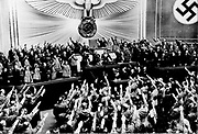 Hitler receives Nazi salutes after a speech in the Reichstag  in 1934.