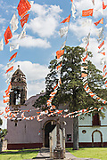 A small Mexican style Catholic Church in the tiny village of Santa Ana Chapitiro, Michoacan, Mexico.