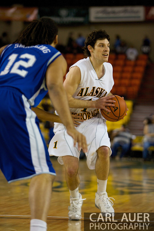 November 26, 2008: University of Alaska-Anchorage guard Kevin White (1) runs the offense in the first half against Hampton in the opening game of the 2008 Great Alaska Shootout at the Sullivan Arena.