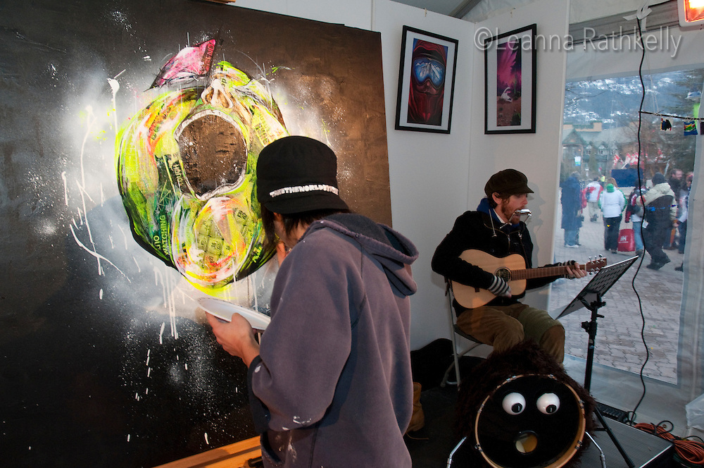 Taka Sudo, a Whistler artist, paints live in the Town Plaza during the 2010 Olympic Winter games in Whistler, BC Canada.