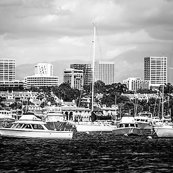 Newport Beach Skyline Black and White Picture. Photo includes Newport Beach skyline with boats in Newport Harbor, luxury homes and Newport Beach office buildings.  Newport Beach is a wealthy beach city along the Pacific Ocean in Orange County Southern California.
