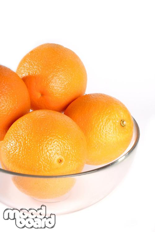 Oranges in bowl - studio shot