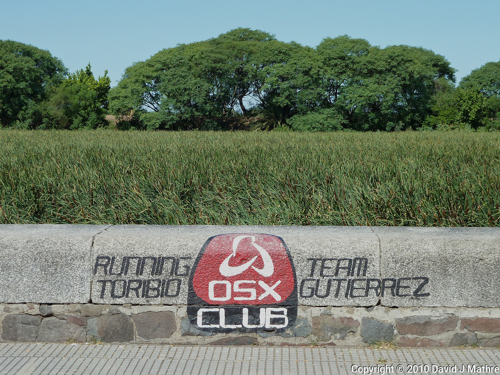 OSX Club sign along Laguna de los Coipos in Buenos Aries. Images taken with a Leica V-Lux 20 camera (ISO 80, 11.9 mm, f/5.6, 1/400 sec)