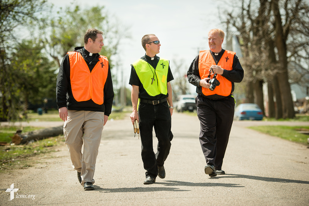 (L-R) The Rev. Michael Meyer, manager of LCMS Disaster Response, the Rev. Brian Bucklew, pastor at Zion Lutheran Church, and the Rev. L. Scott Spiehs, pastor of St. John's Lutheran Church and South Dakota District Response Coordinator, walk the neighborhood around  Zion Lutheran Church on Tuesday, May 12, 2015, in Delmont, S.D. A tornado swept through the area on Sunday and destroyed the church along with nearby buildings. LCMS Communications/Erik M. Lunsford