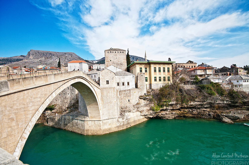 The Stari Most, or Old Bridge, spanned the Neretva River,  which flows through Mostar,in Bosnia Herzegovina, for 427 years. It was built in the 16th century by the Ottomans and was destroyed on November 9, 1993 during the Croat-Bosniak War (which took place during the larger Bosnian War). After the war, several international organisations, including UNESCO and the World Monuments Fund, formed a coalition to rebuild the bridge and the surrounding area. In 2001, reconstruction began with the aim to use similar technology and the same local materials as the original. The rebuilt bridge was inaugurated on 23 July 2004.