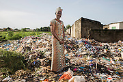 Isatou Ceesay stands at a waste dump behind a market in the town of Yundum. Mrs Ceesay founded the Women's Initiative Gambia in 1997. The organisation works with communities across the tiny west African state to address not only the environmental impact of unregulated waste disposal, particularly plastic, but also the empowerment of women in the make dominated society. Over one hundred women are now involved in Isatou's project.