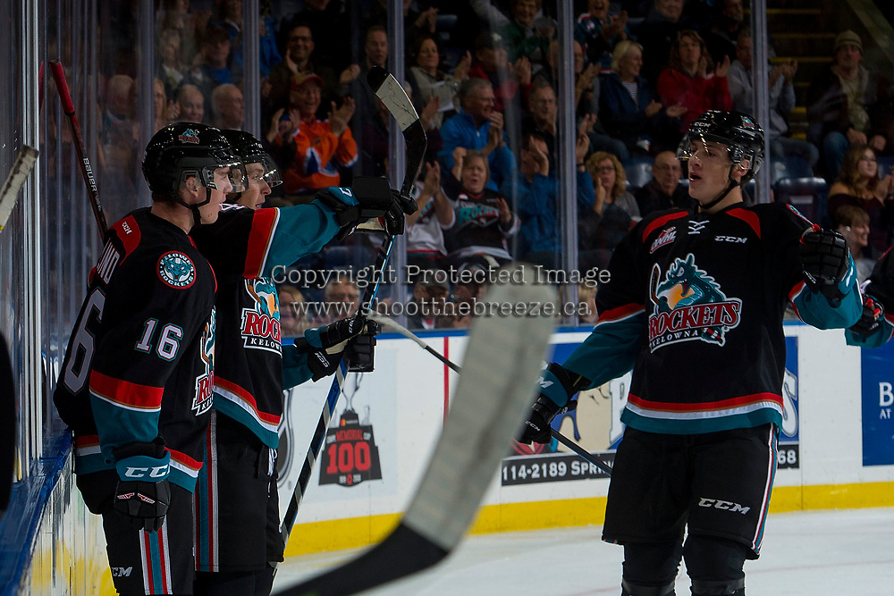 KELOWNA, CANADA - OCTOBER 4: Kole Lind #16 , Gordie Ballhorn #4 and Cal Foote #25 of the Kelowna Rockets celebrate a goal at the boards against the Victoria Royals on October 4, 2017 at Prospera Place in Kelowna, British Columbia, Canada.  (Photo by Marissa Baecker/Shoot the Breeze)  *** Local Caption ***