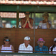 Spectators watch the singles competition during the 2009 ITF Super-Seniors World Team and Individual Championships at Perth, Western Australia, between 2-15th November, 2009.