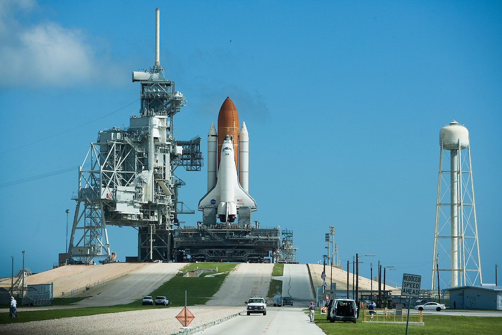 CAPE CANAVERAL, FL - AUGUST 29:  Space Shuttle Atlantis off of launch pad 39-b and back to the vehicle assembly building atop a crawler transporter in preparation for approaching tropical storm Ernesto at Cape Canaveral, Florida, August 29, 2006. The launch of Atlantis was originally scheduled for August 27 but was delayed due to a lightning strike and now the tropical storm. (Photo by Matt Stroshane/Getty Images)