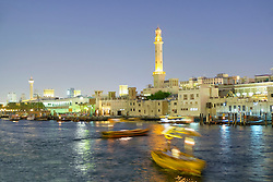 Night view of abra water taxis on The Creek in Deira in old Dubai united Arab Emirates