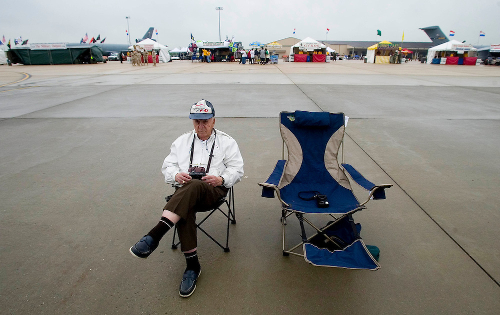 Bill DeSante of Fair Haven sits lonely on the flight line at McGuire AFB.  Weather had delayed the in air portion of the show.  Bill was a WW-II fighter pilot.