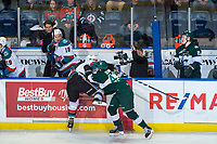 KELOWNA, CANADA - FEBRUARY 2: Connor Dewar #43 of the Everett Silvertips checks a player of the Kelowna Rockets into the boards during first period on FEBRUARY 2, 2018 at Prospera Place in Kelowna, British Columbia, Canada.  (Photo by Marissa Baecker/Shoot the Breeze)  *** Local Caption ***