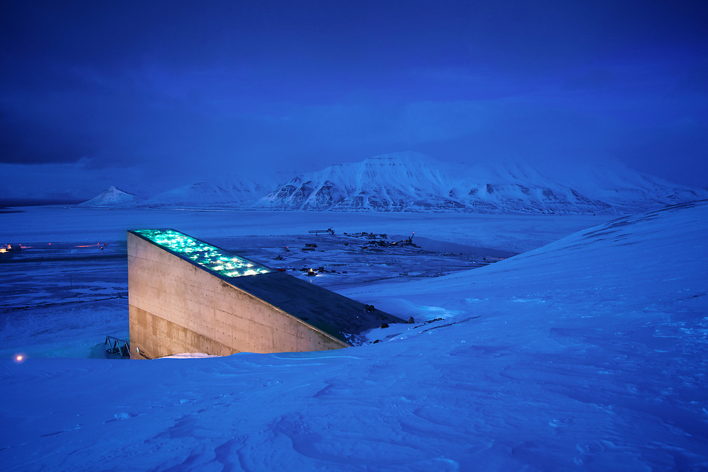 "Carey Fowler at the ""Doomsday"" seed bank in Longyearbyen, Svalbard, Norway.  Dug into the frozen mountainside above the town, the seedbank is a last chance repository for millions of seeds, that could be used to restore agriculture should a disaster wipe out many of the plants we depend upon for food."