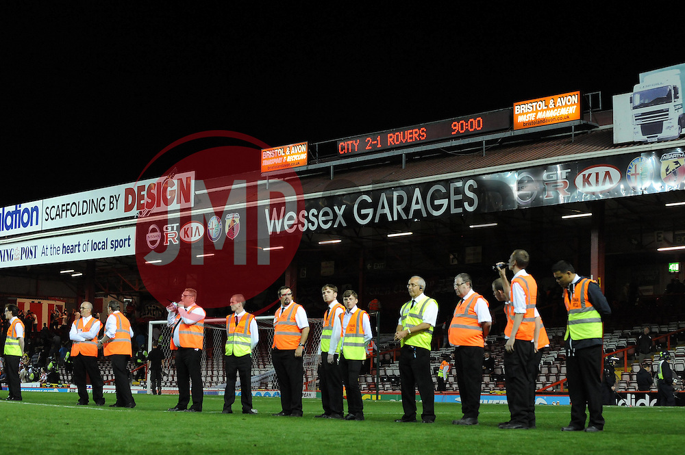 Stewards stand in a line below the scoreboard  - Photo mandatory by-line: Dougie Allward/JMP - Tel: Mobile: 07966 386802 04/09/2013 - SPORT - FOOTBALL -  Ashton Gate - Bristol - Bristol City V Bristol Rovers - Johnstone Paint Trophy - First Round - Bristol Derby
