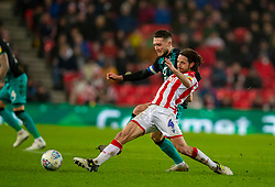 STOKE-ON-TRENT, ENGLAND - Saturday, January 25, 2020: Stoke City's captain Joe Allen (R) and Swansea City's captain Matt Grimes during the Football League Championship match between Stoke City FC and Swansea City FC at the Britannia Stadium. (Pic by David Rawcliffe/Propaganda)