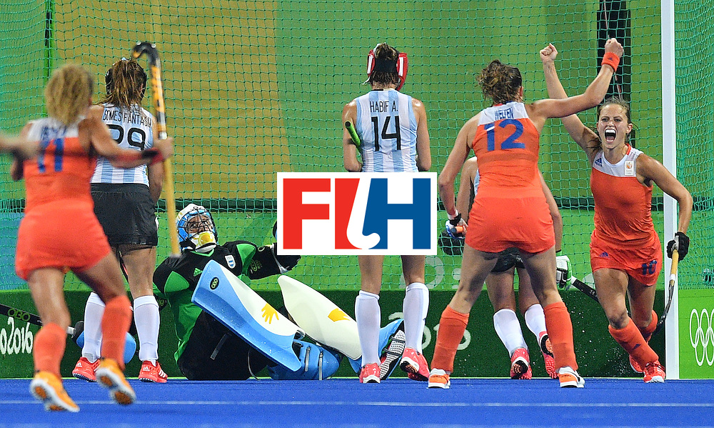 Netherland's Kelly Jonker (R) celebrates after scoring a goal during the women's quarterfinal field hockey Netherland vs Argentina match of the Rio 2016 Olympics Games at the Olympic Hockey Centre in Rio de Janeiro on August 15, 2016.  / AFP / Carl DE SOUZA        (Photo credit should read CARL DE SOUZA/AFP/Getty Images)